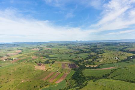 Flying birds-eye view farmlands crops valley  landscape summer green photo.