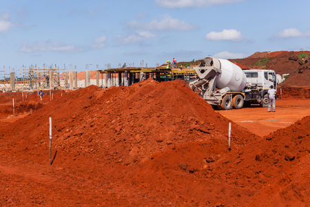 Construction industrial building site with concrete cement truck delivery for foundations. Stock Photo