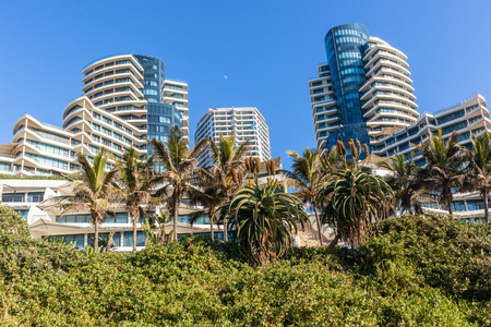 Beach ocean landscape with flat apartment buildings