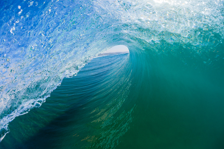 Ocean wave surfer surfing hollow view tube ride inside outward water photo.