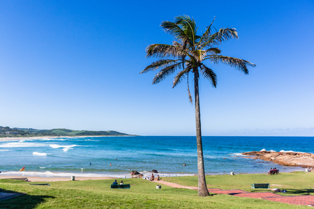 Scenic beach blue water ocean green lawn at Scottborough a surfers surfing fishing sporting holiday landscape.