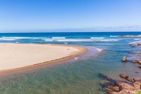 Scenic beach blue water ocean and river mouth at Scottborough a surfers surfing fishing sporting holiday landscape.