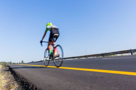 Cycling Cyclist road race riding overhead photo of motion speed blur action.