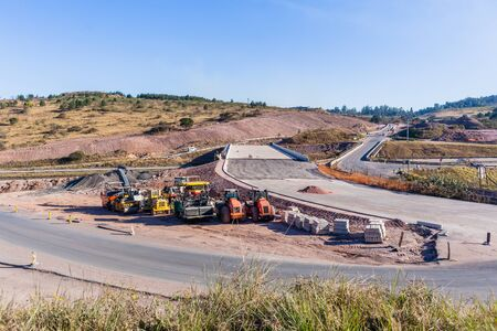 New Bridge Road Highway industrial construction machines expansion near completion of route lanes entry exit ramps to existing network.