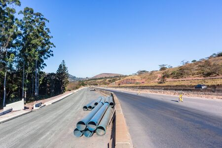 Road Highway industrial construction expansion of new traffic routes lanes entry exit ramps to existing network.