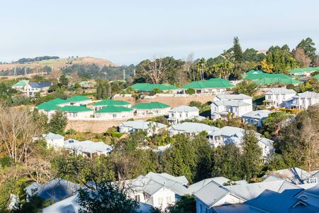 Town houses duplicate homes  built in gated community countryside landscape.