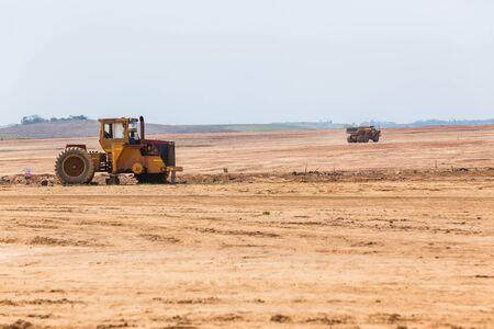 Industrial truck tipper bin moves earth on new industrial property earthworks development platform in countrysidse