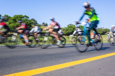 Cyclists bike  riding on the road closeup motion speed blur cycling public race.