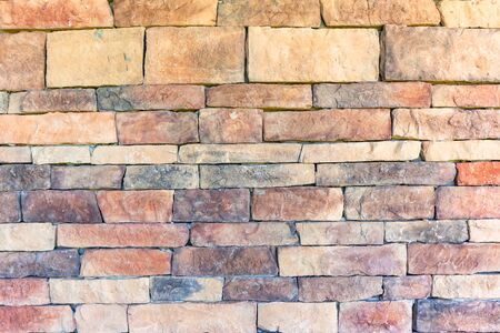 Stone slate block wall closeup raw decor art design detail background hand built natural earth materials.