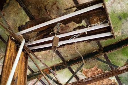 deteriorated light fixture and debris at abandoned school site Foto de archivo