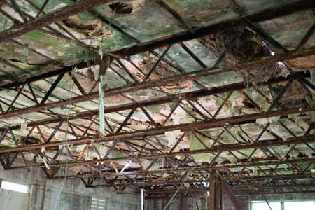 rotted ceiling and rusted structure in abandoned school