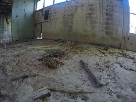 deteriorated light fixture and building debris