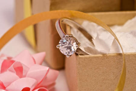 Diamond ring in a box that has just been unwrapped. Stock Photo - 4558435