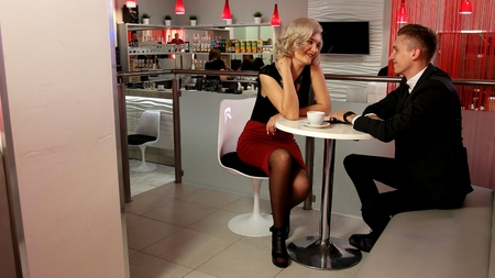 Young couple in love a guy and a girl on a date in the Café