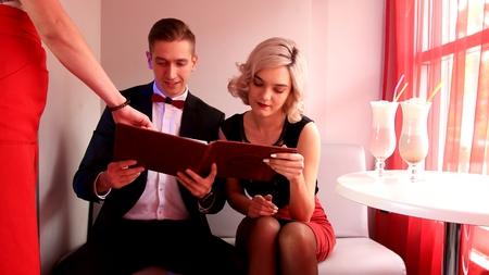 Young couple date in look Café menu 写真素材