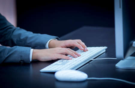 Businesswoman typing at computer photo