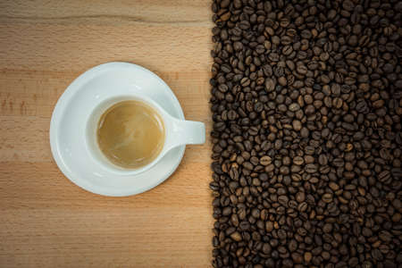 Coffee beans heart isolated on wood background
