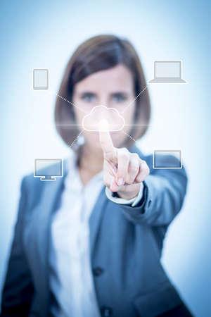 Businesswoman touching visual screen photo