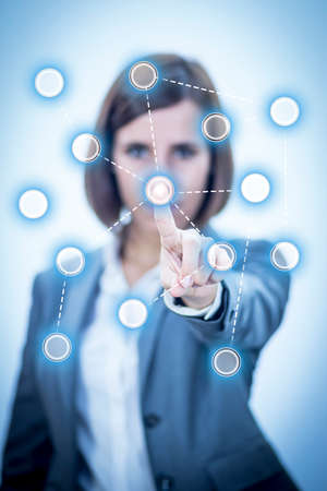 Businesswoman touching Screen Concept Networks photo