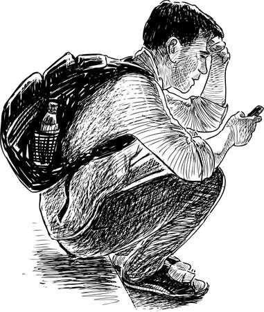 Müder junger Mann mit einem Handy sitzt Standard-Bild - 89286743