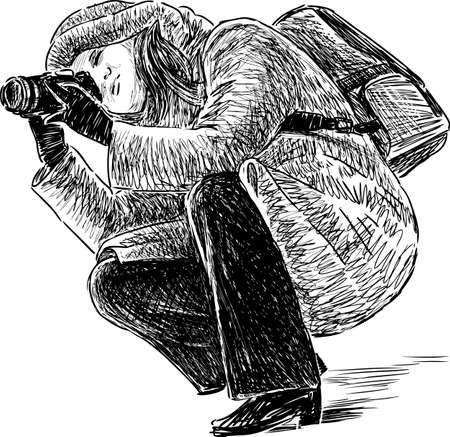 A crouching photographer takes picture