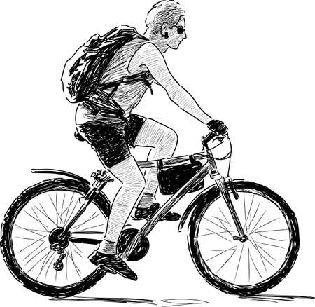 backview: Young person travels on a bicycle