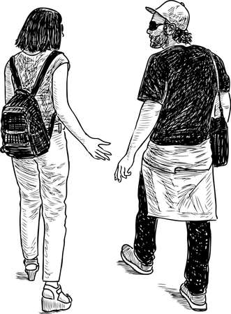 A couple of townspeople walk and talk Foto de archivo - 121511357