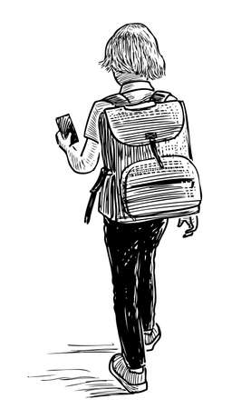 A little schoolboy with a cell phone goes to school