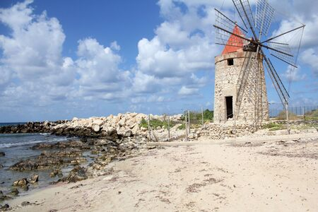 trapani: windmill by the sea in Trapani, Sicily
