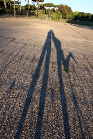 shadow of couple on sunset in Rome photo