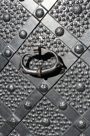 closeup of renaissance, iron gate with a knocker  photo