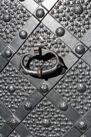 closeup of renaissance, iron gate with a knocker  photo