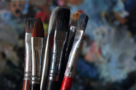 dirty brushes and palette in the background  photo
