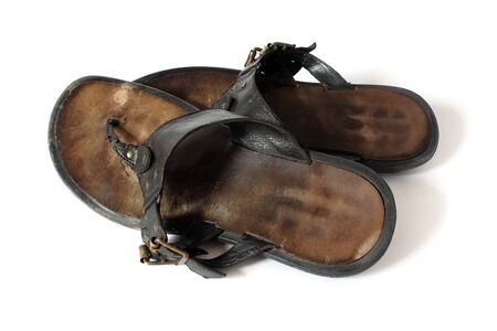 Pair of used leather sandals  flip flops photo