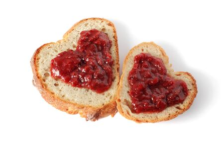 strawberry jam sandwich: heart shaped bread with strawberry jam on the top