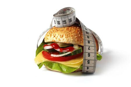 sandwich with fresh vegetables, cheese and measuring tape  photo