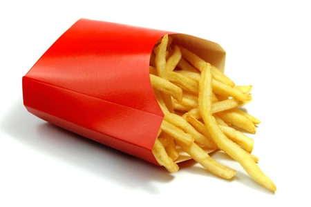 french fries in a red paper wrapper on white  Stock Photo