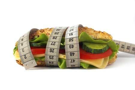 healthy sandwich with vegetable and cheese and measuring tape isolated on white  photo
