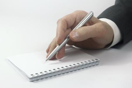 part des affaires avec le stylet sur ordinateur portable Banque d'images