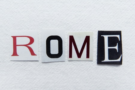 word rome cut from newspaper on handmade paper  photo