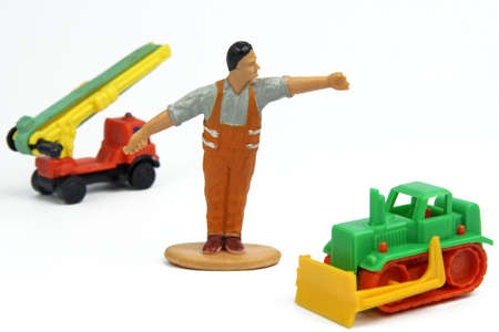 toy figure of street builder and bulldozer photo