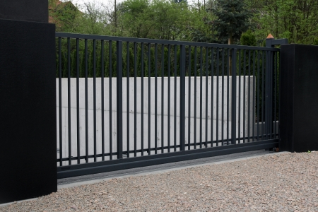 iron fence: black modern gate   Stock Photo