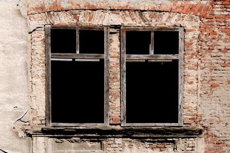 tenement: grunge empty windows on old brick wall  Stock Photo