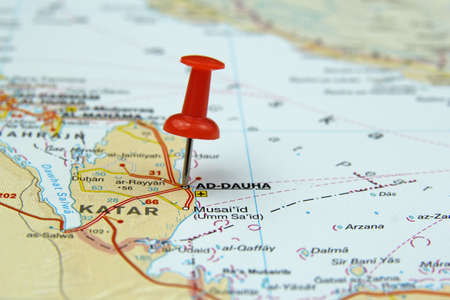 push pin pointing at Doha, Qatar
