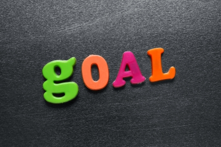 word goal spelled out using colored fridge magnets Stock Photo - 20038789