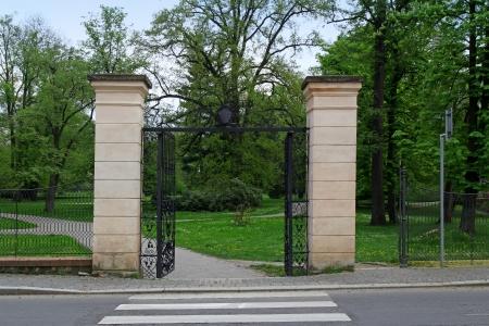 open garden gate: an opened iron gate