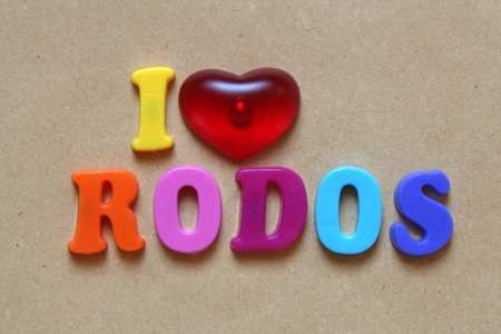 i love rodos spelled out using colored magnets  photo