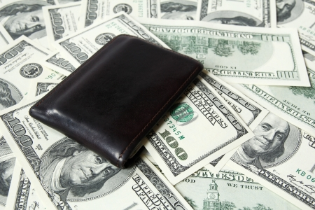leather wallet and one hundred dollar bills  photo
