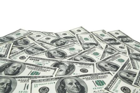 one hundred dollar bills on white background