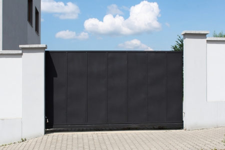 Modern black gate and sky in the background Stock fotó - 20780495